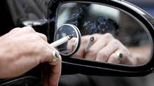 The British Medical Association has called for a ban on smoking in cars. In Canada, it is already illegal to smoke with children in the vehicle. (PHIL NOBLE/REUTERS)