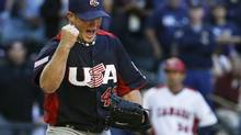 United States' Craig Kimbrel shouts and pumps his fist as Canada coach Tim Leiper puts his hands on his hips after the final out is recorded in the ninth inning for a United States win during a World Baseball Classic baseball game on Sunday, March 10, 2013, in Phoenix. The United States defeated Canada 9-4. (Ross D. Franklin/The Associated Press)