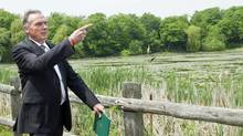 Environment Minister Peter Kent shows off part of what will beocme Rouge National Urban Park in Scarborough, Ont., on May 25, 2012. (Nathan Denette/THE CANADIAN PRESS)