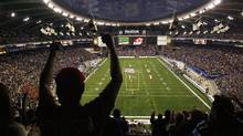 Fans cheer before the Montreal Alouettes play the Calgary Stampeders during the CFL's 96th Grey Cup football game at Olympic Stadium in Montreal, November 23, 2008. (Reuters)