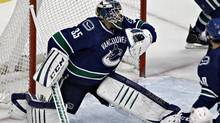 The puck goes past Vancouver Canucks goalie Cory Schneider into the net off the stick of Phoenix Coyotes Mikkel Boedker during the second period of their NHL game in Vancouver, British Columbia February 26, 2013. (ANDY CLARK/REUTERS)