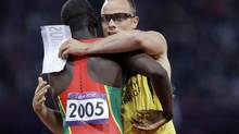 South Africa's Oscar Pistorius embraces Grenada's Kirani James after the men's 400-metre semi-final during the athletics in the Olympic Stadium at the 2012 Summer Olympics, London, Sunday, Aug. 5, 2012. (Anja Niedringhaus/AP)