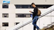 A student walks down the steps of Engineering building at the University of Waterloo campus while using his mobile phone in front of the Blackberry maker's Research in Motion building April 18, 2012. (MARK BLINCH/Mark Blinch/Reuters)
