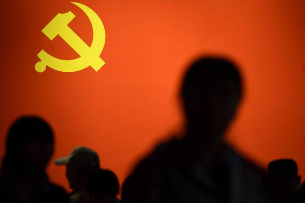 A party flag of the Chinese Communist Party is displayed at an exhibition showcasing China's progress in the past five years at the Beijing Exhibition Center.