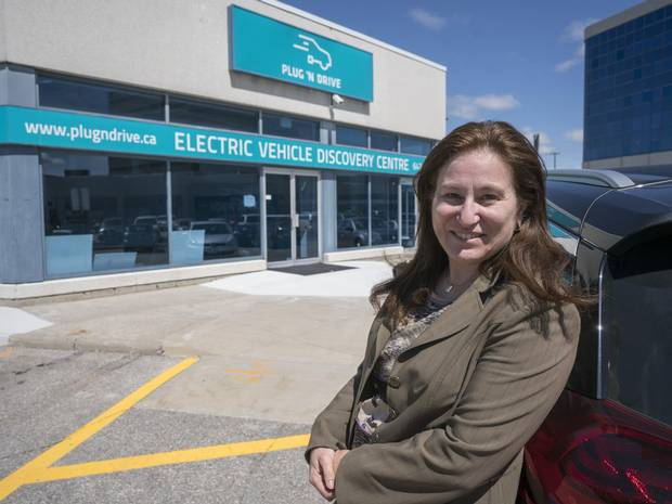 Cara Clairman, president of the Electric Vehicle Discovery Centre in Vaughan, Ont., stands outside the non-profit's retail location on Monday. The centre officially opens next week.