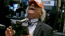 Trader Peter Tuchman jokes with a handmade 'Dow 17,000' cap as he works on the floor of the New York Stock Exchange, Tuesday, July 1, 2014. The stock market climbed to all-time highs after reports showed that manufacturing in the U.S. and China expanded in June, boosting the outlook for global growth. (Richard Drew/AP)