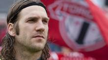Toronto FC 's captain and former World Cup winner Torsten Frings takes his place on the bench before his team's 1-0 defeat to Chivas USA MLS action in Toronto on Saturday April 14, 2012, as Frings nears his return to action after injury. THE CANADIAN PRESS/Chris Young (Chris Young)
