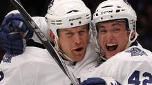 Toronto Maple Leafs' Mike Komisarek (L) celebrates with his teammate Tyler Bozak after Komisarek's goal against the New York Rangers in the second period of their NHL hockey game in New York October 15, 2010. REUTERS/Mike Segar (MIKE SEGAR)