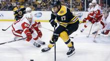 Boston Bruins' Milan Lucic (17) and Detroit Red Wings' Johan Franzen (93) battle for the puck during the second period in Game 5 of a first-round game in the NHL hockey Stanley Cup playoffs, in Boston, Saturday, April 26, 2014. The Bruins won 4-2. (Michael Dwyer/THE ASSOCIATED PRESS)