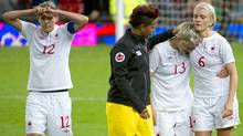 Canada's women's soccer team reacts after losing to the U.S. at the 2012 Summer Olympics in Manchester, England, Sunday August 5/2012. (Kevin Van Paassen/The Globe and Mail)