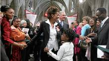 In September, 2005, Michaelle Jean, newly sworn in as Governor General greets people in the Hall of Honour on Parliament Hill, with her then-six year-old daughter Marie-Eden Jean, in front, and then-Prime Minister Paul Martin in back. (JONATHAN HAYWARD/CP)