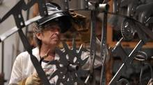 Bob Dylan dons a welder's mask in his L.A. art studio. 'I've been around iron all my life,' says the native of Minnesota's iron-ore country. (John Shearer)