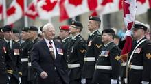 Governor General David Johnston inspects an honour guard prior to the Speech from the Throne in the Senate Chamber on Parliament Hill in Ottawa, Wednesday, October 16, 2013. (Justin Tang/THE CANADIAN PRESS)