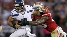Seattle Seahawks quarterback Russell Wilson (L) is tackled by San Francisco 49ers linebacker NaVorro Bowman during the first half of their NFL game in San Francisco, California October 18, 2012. (ROBERT GALBRAITH /REUTERS)