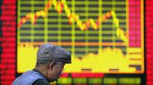 There are managed funds that have beaten the market, but it's rare for a winning fund to continue its winning ways. An investor stands in front of an electronic board showing stock information at a brokerage house in Shanghai February 4, 2008. China's main stock index jumped more than 8 percent on Monday in its biggest daily rise since June 2005, after authorities intervened to halt a three-week slide in share prices. REUTER/Nir Elias (CHINA) (NIR ELIAS/REUTER)