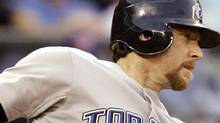 Toronto Blue Jays' Gregg Zaun hits a single against the Seattle Mariners in the sixth inning of a baseball game Tuesday, July 1, 2008, in Seattle. (AP Photo/Elaine Thompson) (Elaine Thompson)