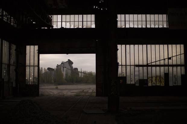 In this Thursday April 6, 2017 photo, a former steel factory is photographed through the gate of an abandoned industrial unit on the outskirts of Rombas, a french city located north east of France, near Hayange. In eastern France's industrial rustbelt, workers are massing behind the virulently nationalistic politics of populist Marine Le Pen.