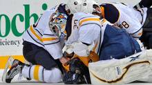 Goalie Ryan Miller #30 of the Buffalo Sabres punches Jordin Tootoo #22 of the Nashville Predators at the Bridgestone Arena on December 3, 2011 in Nashville, Tennessee. (Photo by Frederick Breedon/Getty Images) (Frederick Breedon/Getty Images)