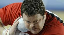 Canada's Dylan Armstrong makes an attempt at the Men's Shot Put qualification during the World Indoor Athletics Championships in Istanbul, Turkey, Friday, March 9, 2012. (The Associated Press)