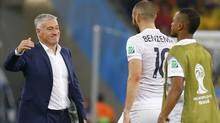France's coach Didier Deschamps smiles at player Karim Benzema after their 2014 World Cup Group E soccer match against Ecuador ended with a draw at the Maracana stadium in Rio de Janeiro June 25, 2014. (Reuters)