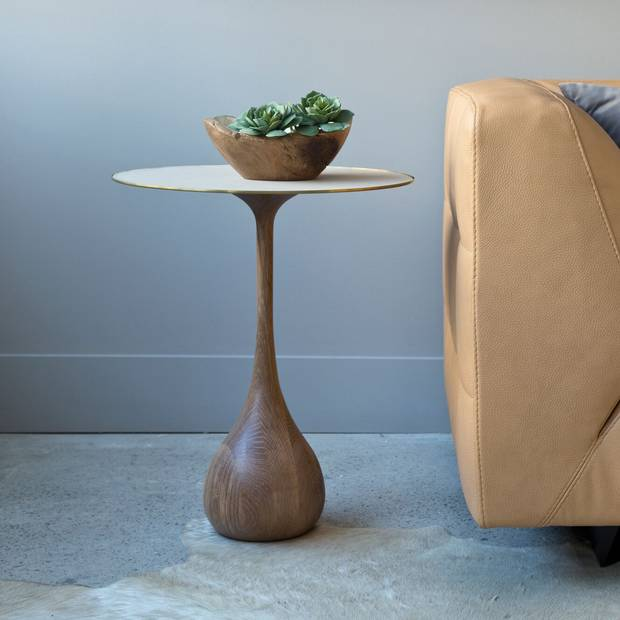 A mezzo side table. Sholto Scruton works with a variety of building materials on both indoor and outdoor furniture, collaborating with designers on custom one-of-a-kind pieces.