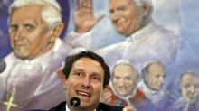 Carlo Fusco, lawyer of pope's personal butler Paolo Gabriele, speaks during a news conference at the Vatican July 21, 2012. Mr. Gabriele, who has been detained on suspicion of leaking documents alleging corruption in the Holy See, acted alone and was not part of any wider plot, his lawyer said on Saturday. Father Federico Lombardi, a Vatican spokesman, said the butler, Paolo Gabriele, had been released from preventive custody and placed under house arrest following a seven hour interrogation on Saturday. (ALESSANDRO BIANCHI/REUTERS)