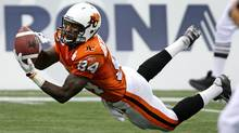 B.C. Lions' Emmanuel Arceneaux dives to catch a pass but drops it after hitting the ground during first half CFL action against the Saskatchewan Roughriders in Vancouver, B.C., on Friday October 2, 2009. (The Canadian Press)