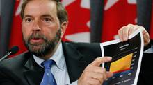 In a 2008 news conference, NDP MP Thomas Mulcair said billions of dollars were going into corporate tax giveaways while working families were forced to pay more for government services.