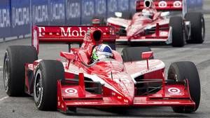 Dario Franchitti (left) leads second place Scott Dixon on a turn turn on his way to winning the Toronto Indy in Toronto on Sunday July 10 , 2011.