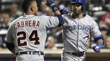 Miguel Cabrera, left, celebrates the American League's first run Tuesday at the All-Star Game with AL teammate Jose Bautista, whose sacrifice fly scored Cabrera. (SHANNON STAPLETON/REUTERS)