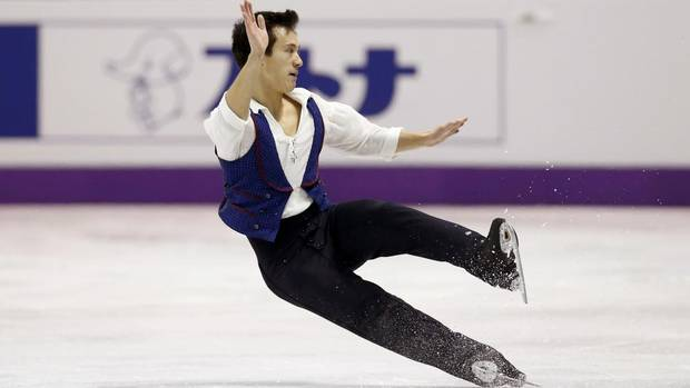 Patrick Chan of Canada falls as he performs his men's free program at the ISU World Figure Skating Championships in London, March 15, 2013. (MARK BLINCH/REUTERS)