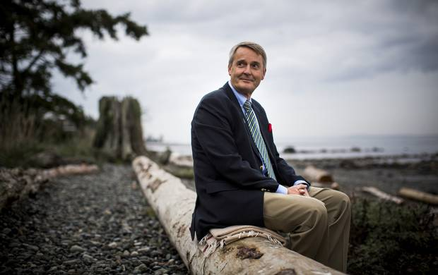 Mayor Teunis Westbroek is pictured on the seawall of Qualicum Beach.