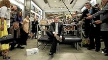 Federal Finance Minister Jim Flaherty tries on his budget shoes at a store in Ottawa on Wednesday. (Chris Wattie/Reuters)