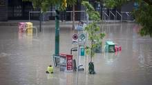 A flooded street in Calgary's Mission neighbourhood, June 21, 2013. (John Lehmann/The Globe and Mail)