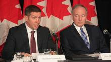 Former NHLer Sheldon Kennedy, left, speaks at a news conference with Justice Minister Rob Nicholson in Toronto on Monday, Feb. 4, 2013. (COLIN PERKEL/THE CANADIAN PRESS)