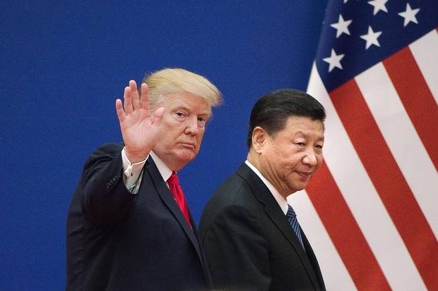 U.S. President Donald Trump and China's President Xi Jinping leave a business leaders' event at the Great Hall of the People in Beijing on Nov. 9, 2017.