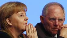 German Chancellor Angela Merkel and Finance Minister Wolfgang Schaeuble. (KAI PFAFFENBACH/REUTERS)