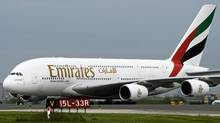 An Emirates aircraft lands at Pearson airport in Toronto on June 1, 2009. (NATHAN DENETTE/The Canadian Press)