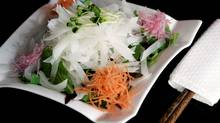 Irashai Grill's daikon salad may look traditional, but it uses a mustard dressing, rather than rice vinegar. (LAURA LEYSHON/LAURA LEYSHON)
