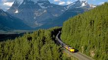 Via Rail's the Canadian making its way through forests overlooked by the Rocky Mountains between Jasper and Vancouver. (VIA RAIL/The Canadian Press/VIA RAIL/The Canadian Press)