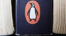 A book on display with the penguin logo. in Cirencester, England. Pearson PLC will merge its Penguin Books division with Random House, which is owned by German media company Bertelsmann, in an all-share deal that will create the world's largest publisher of consumer books, it was reported on Monday, Oct. 29, 2012. (Tim Ireland/AP)