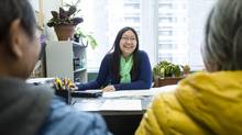 Husband and wife Liang Xi Hong, left, and Feng Su Na meet Monday with Phoebe Luo, a career counsellor at Immigrant Services' Calgary offices. (Chris Bolin for The Globe and Mail)
