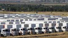 A Russian convoy of trucks carrying humanitarian aid for Ukraine is parked at a camp near Kamensk-Shakhtinsky, Rostov Region, Aug. 16. (MAXIM SHEMETOV/REUTERS)