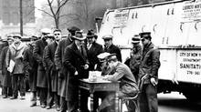 Men line up at City Hall in New York to apply for snow-clearing jobs during the Depression. (AP)