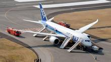 An All Nippon Airways flight sits at Takamatsu airport in Takamatsu, western Japan after it made an emergency landing Jan. 16, 2013. (Kyodo News/AP)