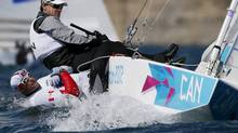 Canadians Tyler Bjorn and Richard Clarke sail in the Star class before a practice race at the London 2012 Olympic Games in Weymouth and Portland, southern England, July 28, 2012. REUTERS/Pascal Lauener (BRITAIN - Tags: SPORT YACHTING OLYMPICS) (PASCAL LAUENER/REUTERS)
