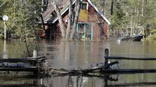 Houses and vehicles remain submerged in flood waters in Hunstville, Ont., on April 21, 2013. Ontario's cottage country is experiencing the worst flooding on record. (J.P. Moczulski for The Globe and Mail)
