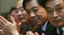 Bo Xilai (2nd R), then Governor of Liaoning Province, pauses at the China Entrepreneur Annual Meeting 2003 in Beijing in this December 7, 2003 file photo. The Seventh Plenary Session of the 17th Central Committee of the Communist Party of China (CPC) on November 4, 2012 endorsed a decision made by the Political Bureau of the CPC Central Committee to expel Bo from the CPC, Xinhua reported. (JASON LEE/REUTERS)