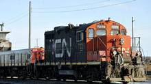 A CN locomotive makes it's way through the CN Taschereau yard in Montreal, Saturday, Nov., 28, 2009. (Graham Hughes/THE CANADIAN PRESS)