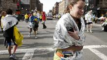 An unidentified Boston Marathon runner leaves the course crying near Copley Square following an explosion in Boston Monday, April 15, 2013. (Winslow Townson/AP)